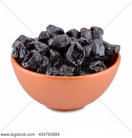 Dried Plums Or Prunes In Brown Bowl Isolated On White Background, Copy Space.