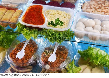 A Variety Of Prepackaged Food Products In Plastic Boxes