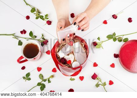 Female Hands With Beautiful Fashionable Manicure Holding A Tube Of Cream. Cosmetics Tube Of Cream In