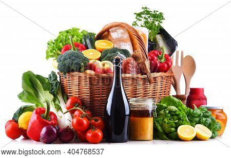 Wicker Basket With Assorted Grocery Products