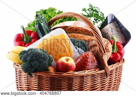 Wicker Basket With Assorted Grocery Products Isolated On White Background