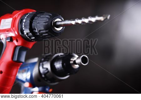 A Pistol-grip Cordless Drill And A Screw Gun
