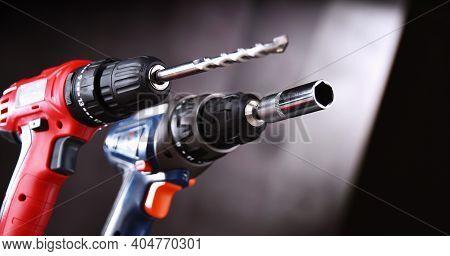 A Pistol-grip Cordless Drill And A Screw Gun.