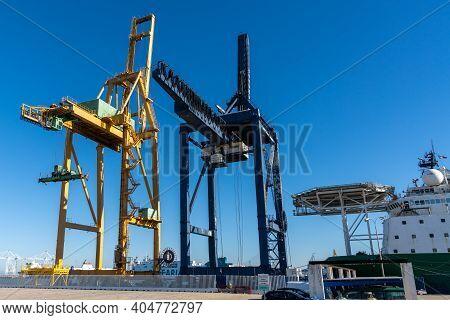 Harbor Cranes On The Docks In The Industrial Port Of Cadiz