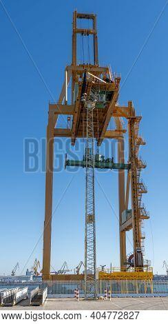 Harbor Crane On The Docks In The Industrial Port Of Cadiz