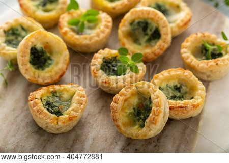 Spinach Mozzarella Mini Quiches Freshly Baked And Ready To Eat For Breakfast Or Snack To Go