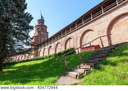 Red Brick Fortress Wall Of The Novgorod Kremlin With Kokuy Watchtower. Veliky Novgorod, Russia