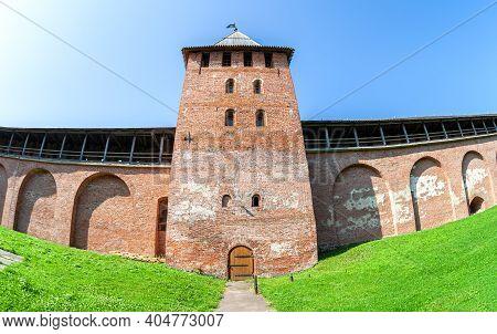 Red Brick Fortress Wall Of The Novgorod Kremlin With Knyazhaya (prince's) Watchtower. Veliky Novgoro