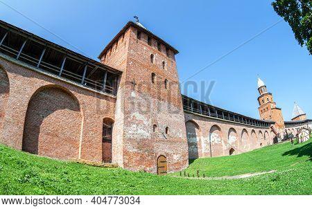 Red Brick Fortress Wall Of The Novgorod Kremlin With Knyazhaya (prince's) And Kokuy Watchtowers. Vel
