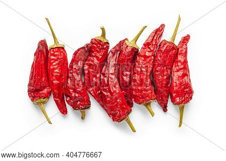 Red Pepper. Dry Peppers Are Grouped On A White Background. Hot Chili Peppers. Spices For Cooking.