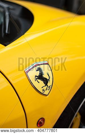 Kyiv, Ukraine - August 2020. Ferrari Nameplate On The Yellow Ferrari 458 Spider.