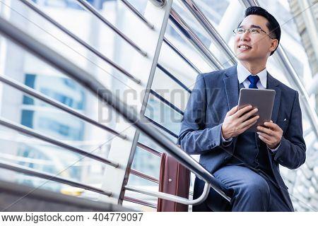Handsome Asian Businessman Holding Digital Tablet, Wear Suit And Eyeglasses. Leadership Executive Bu