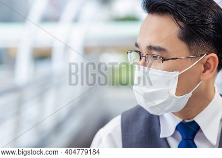 Business Man Wear Medical Face Mask For Protecting Air Pollution And Covid 19 Asian Guy Thinking Som