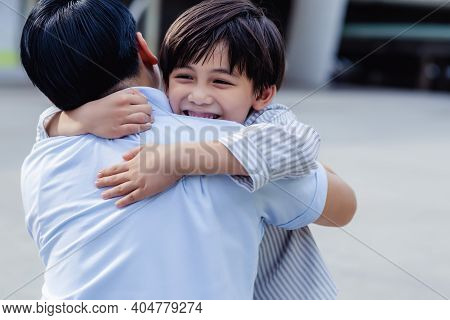 Happy Family Concept Handsome Young Asian Boy Hugging His Father When He Meet Dad. Portrait Smiling