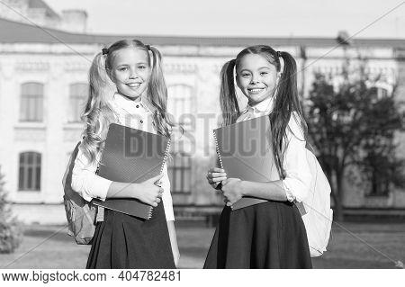 Friendship Doubles Joys. Happy Children Back To School. Little Kids Hold Books Outdoors. School Frie