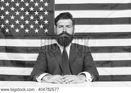American Patriotism. American Citizen In Formalwear. Bearded Man On American Flag Background. Indepe