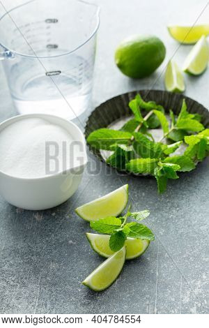 Making Mojito Cocktail With Mint Simple Syrup, Fresh Mint And Limes