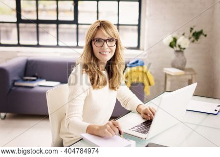 Shot Of Middle Aged Woman Working From Home