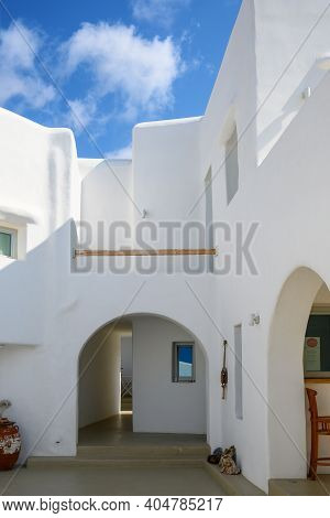 Ios, Greece - September 22, 2020: A Whitewashed Summer Villa In The Cyclades Style On Ios. Greece