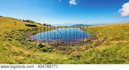Pond On The Mountain Meadow. Beautiful Summer Landscape In Morning Light. Grass On The Hills. Ridge