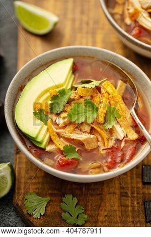 Slow Cooker Chicken Taco Soup Topped With Fresh Cilantro And Avocado