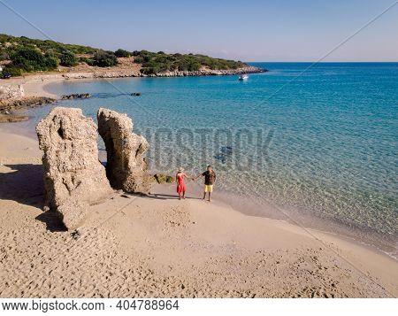 Young Happy Couple On Seashore Crete Greece, Men, And Woman Voulisma Beach Crete Greece. Europe