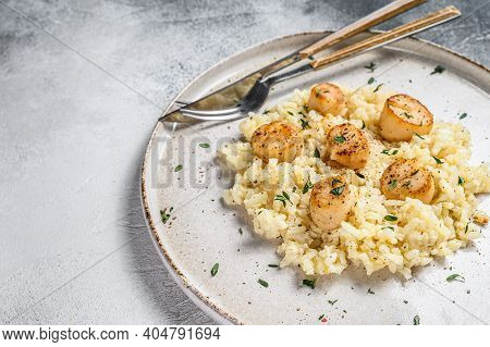 Italian Risotto With Pan Seared Sea Scallops. White Background. Top View. Copy Space