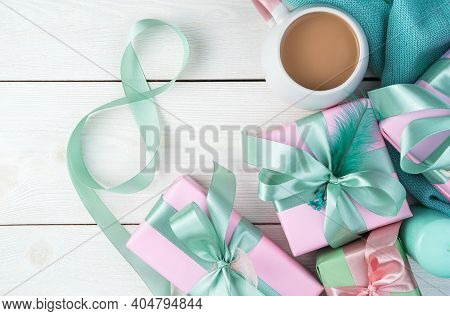 March 8, Number 8, Gifts And Coffee On A White Wooden Background.