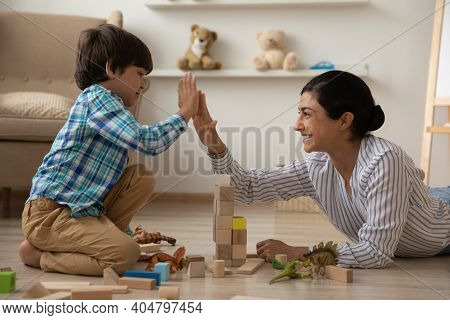 Laughing Indian Mommy Give High Five To Happy Kid Son