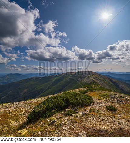 Summer Sunshine Above Carpathian Mountains. View From Stony Vysoka Mountain To Ihrovets And Other Go