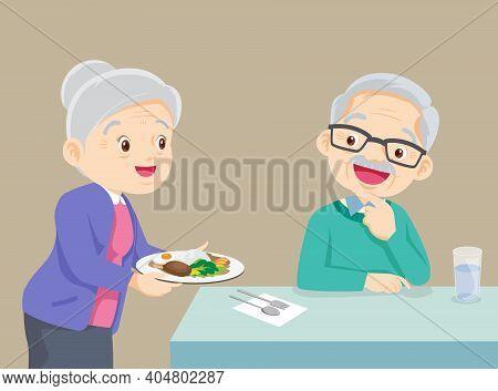 Elderly Woman Serving Food To Elderly Man, Lovely Grandmother Serving Food To Grandfather, Family En