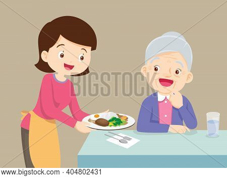 Woman Serving Food To Elderly Woman, Lovely Daughter Serving Food To Mother, Family Enjoy Cooking.