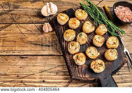 Bbq Seared Scallops With Butter Sauce On A Wooden Board. Wooden Background. Top View. Copy Space