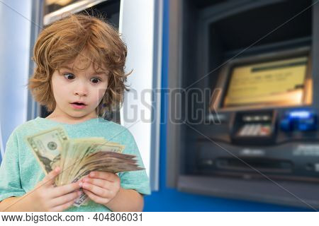 Piggy Bank Investments. Saving Money. Child With Dollars. Banking And Finance