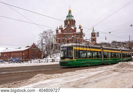 Helsinki. Finland. January 19, 2021 Snowy Helsinki. Modern Tram On A Snowy Winter Street. Old Colorf