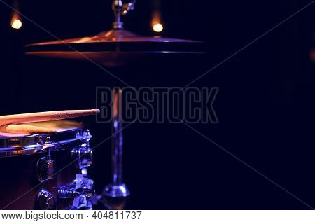 Part Of A Drum Kit In The Dark With Beautiful Lighting. Concert And Performance Concept.