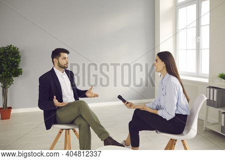 Famous Person Sitting In Tv Studio And Giving Interview To Television Journalist