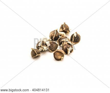 Unpeeled And Kernel Of Moringa Or Drumstick, Benzolive Seeds Isolated On White Background