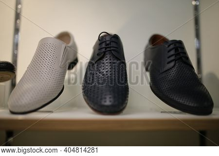 Stylish Leather, Lacquered Mens Shoes On The Shelf In The Store. Black, Brown Mens Shoes On The Stan