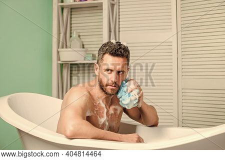 Desire And Temptation. Personal Care. Sexy Man In Bathroom. Man Wash Muscular Body With Foam Sponge.