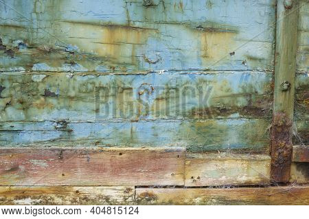 Old Peeling Paint On Old Wooden Planks Grunge Background From Old Ships Hull.