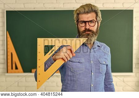 Theorem. Talented Teacher. Science Concept. Mature Bearded Teacher In Glasses. Private Lesson. Back