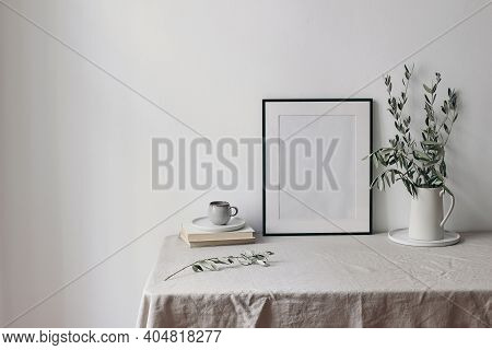 Spring, Summer Breakfast Still Life Scene. Cup Of Coffee, Books And Empty Black Picture Frame Mockup