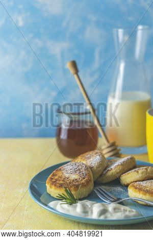 Cottage Cheese Pancakes, Syrniki, Ricotta Fritters On Ceramic Plate. Gourmet Healthy Delicious Morni