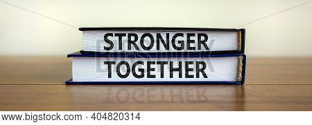 Stronger Together Symbol. Concept Words 'stronger Together' On Books On A Beautiful Wooden Table, Wh
