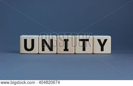 Time To Unity Symbol. Concept Word Unity On Wooden Cubes On A Beautiful Grey Background. Business An