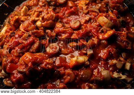 Vegetarian Mushrooms Chickpea Stew In A Iron Pan On A Dark Background, Top View. Healthy Vegetarian