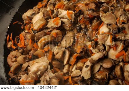 Mushrooms With Slices Of Carrots In A Pan. Pieces Of Raw Mushrooms And Carrots In A Pan. Mushrooms W
