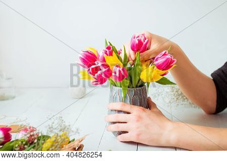 No Face Young Man Making Spring Bouquet Using Tulips. Online Self-education Of Floristry. Learning F