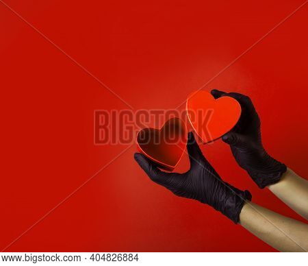 Coronavirus Valentines Concept. Hands Wearing Protective Latex Gloves Holding Red Heart Shaped Box F